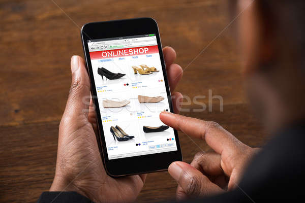 Person Doing Shopping Online On Mobilephone Stock photo © AndreyPopov