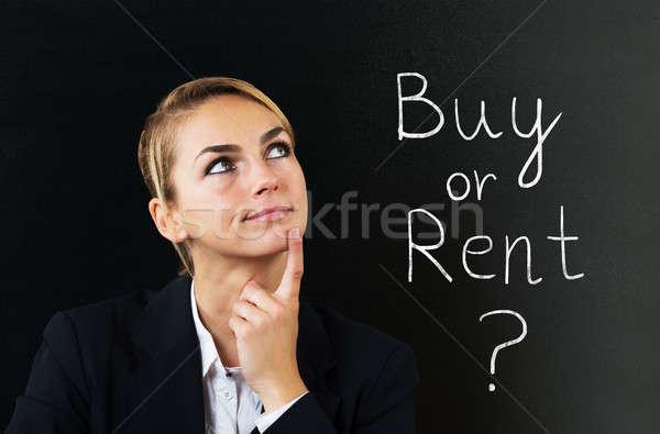 Empresária pensando escolher comprar alugar jovem Foto stock © AndreyPopov