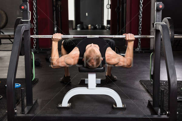 Man Working Out With Barbell Stock photo © AndreyPopov
