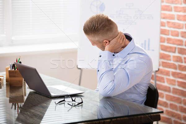 Işadamı boyun ağrısı oturma büro dizüstü bilgisayar ofis Stok fotoğraf © AndreyPopov
