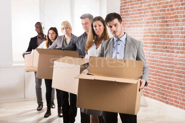 Row Of Businesspeople Standing With Cardboard Boxes Stock photo © AndreyPopov