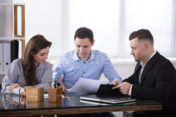 Advisor Discussing With Couple Stock photo © AndreyPopov