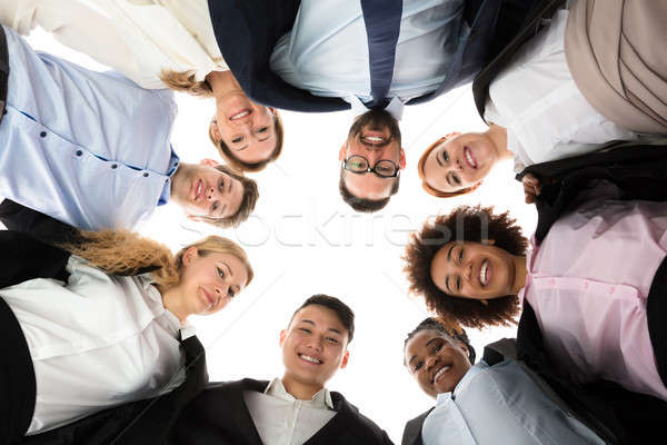 Happy Businesspeople Forming Huddle Stock photo © AndreyPopov