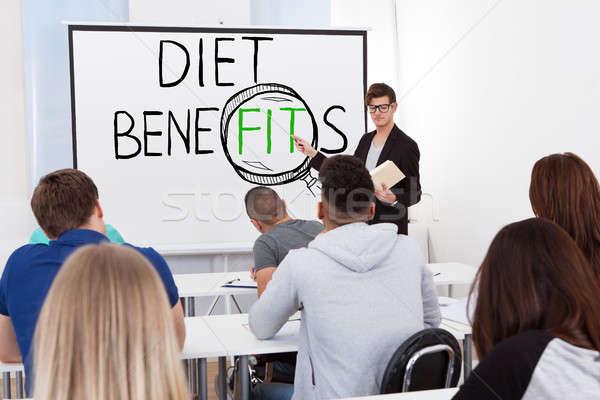 Diéta fogyókúra bemutató férfi nők diák Stock fotó © AndreyPopov
