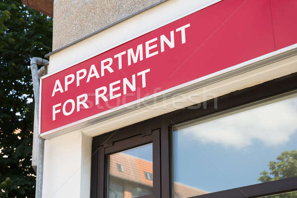 Apartment for rent sign on modern building in city Stock photo © AndreyPopov
