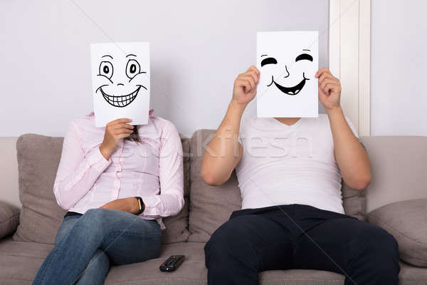 Couple Holding Smiling Faces In Front Of Their Faces Stock photo © AndreyPopov