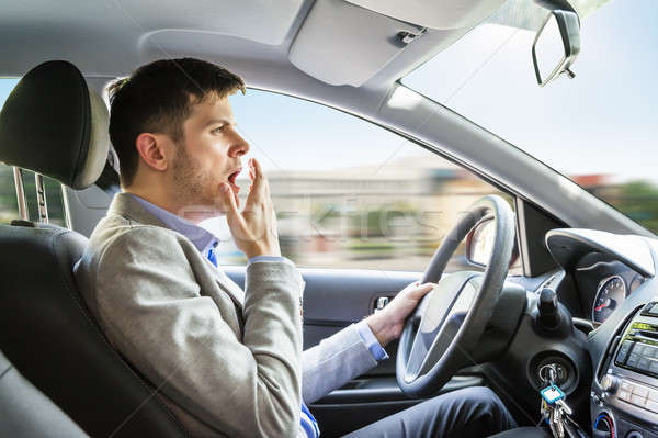 Man Yawning While Driving Car Stock photo © AndreyPopov