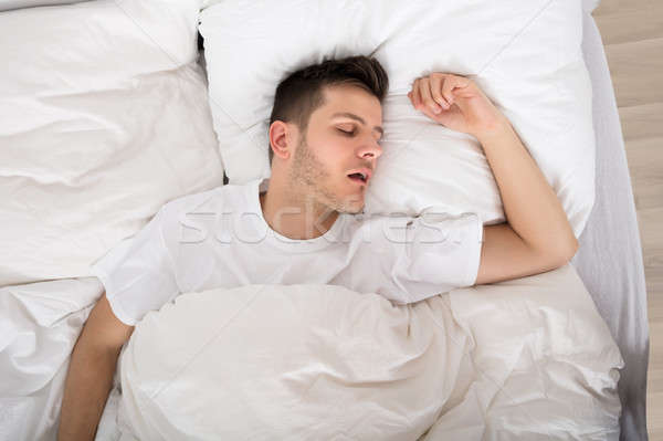 Tired Young Man Snoring Stock photo © AndreyPopov