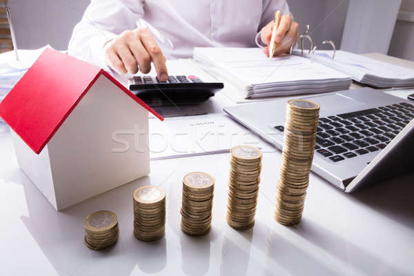 Businessman Calculating House Invoice Stock photo © AndreyPopov