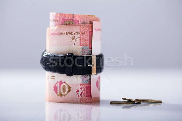 Rolled Up Ukrainian Hrivna Tied With Belt Stock photo © AndreyPopov