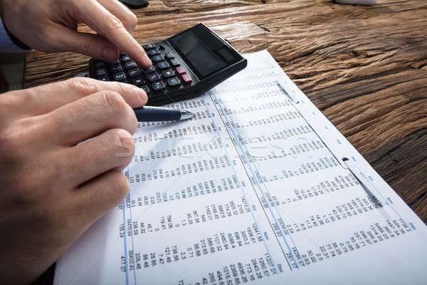 Kéz pénzügyi adat számológép közelkép fából készült Stock fotó © AndreyPopov