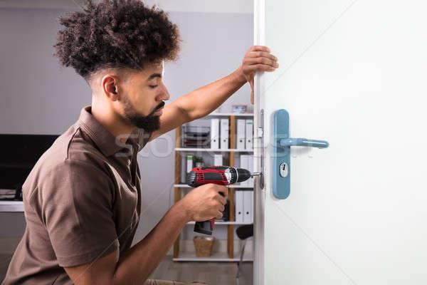 ács installál ajtó zár drótnélküli csavarhúzó Stock fotó © AndreyPopov