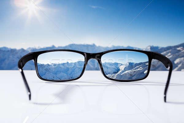 Snowcapped Mountains Seen Through Glasses Stock photo © AndreyPopov
