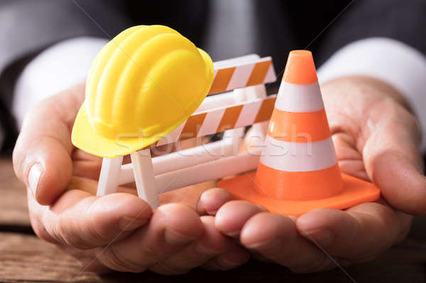 Close-up Of Barricade With Traffic Cone And Hard Hat Stock photo © AndreyPopov