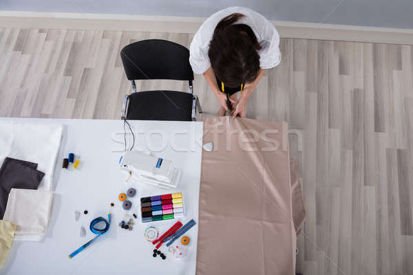 Female Fashion Designer Cutting Cloth With Scissors Stock photo © AndreyPopov
