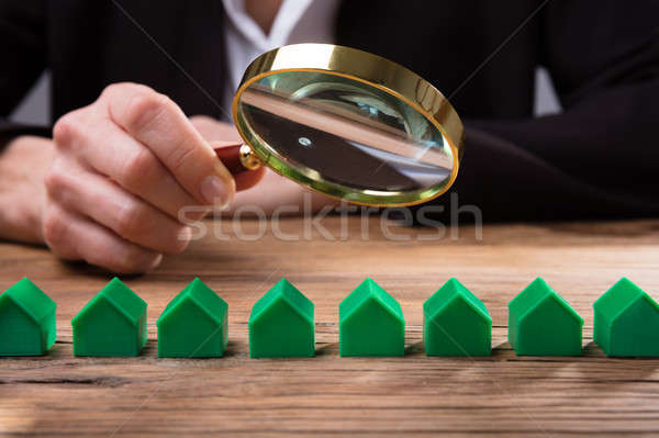 Businessperson Holding Magnifying Glass Over House Model Stock photo © AndreyPopov