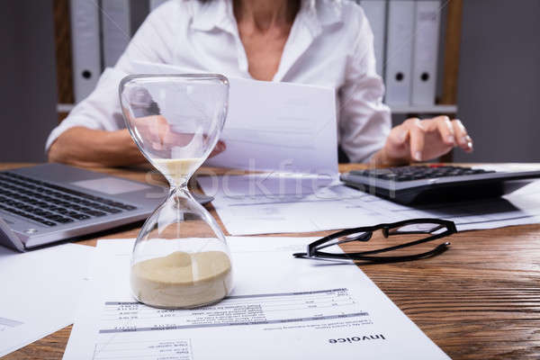 Close-up Of A Hourglass On Invoice Stock photo © AndreyPopov