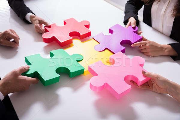 グループ ジグソーパズル デスク ビジネス ストックフォト © AndreyPopov