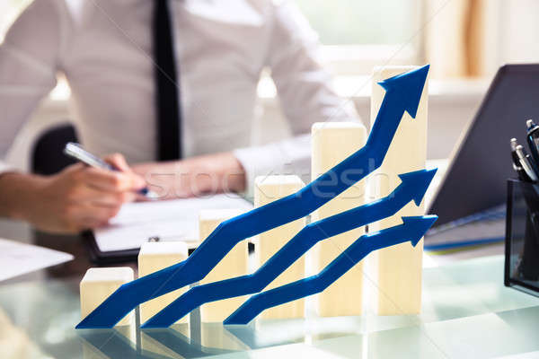 Blue Arrows In Front Of Graph Showing Upward Direction Stock photo © AndreyPopov