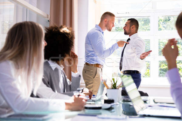 Two Male Colleagues Fighting In Office Stock photo © AndreyPopov