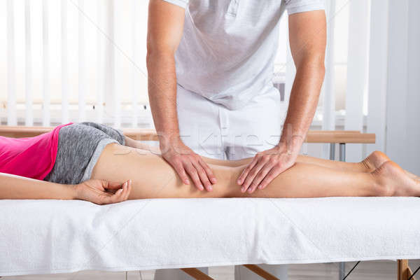 Female Patient Receiving Massage By Therapist Stock photo © AndreyPopov