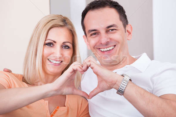 Happy Mid-adult Couple Forming Heart Shape Together Stock photo © AndreyPopov