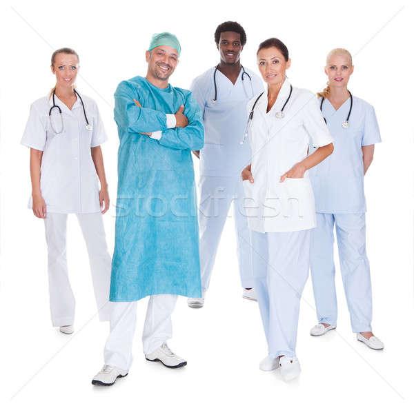 Feliz médico quirúrgico vestido aislado Foto stock © AndreyPopov