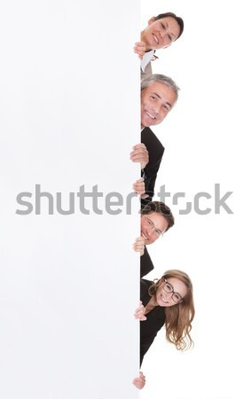 Group Of Businesspeople Holding Placard Stock photo © AndreyPopov