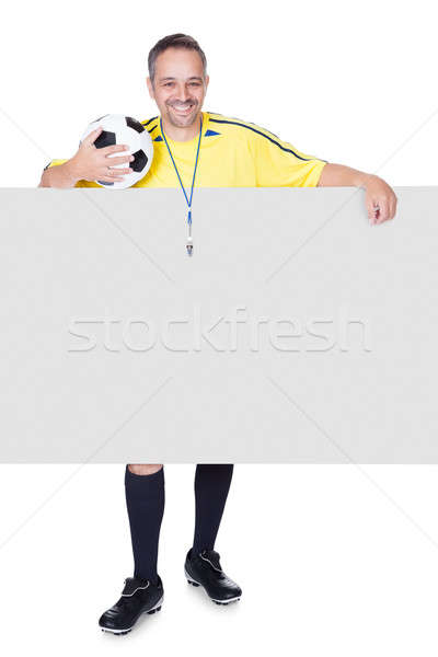 Happy Coach Holding Placard And Football Stock photo © AndreyPopov