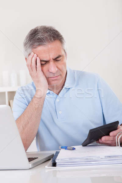 Mature Man Doing Finances Stock photo © AndreyPopov