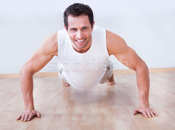 Young Man Performs Pushup Stock photo © AndreyPopov