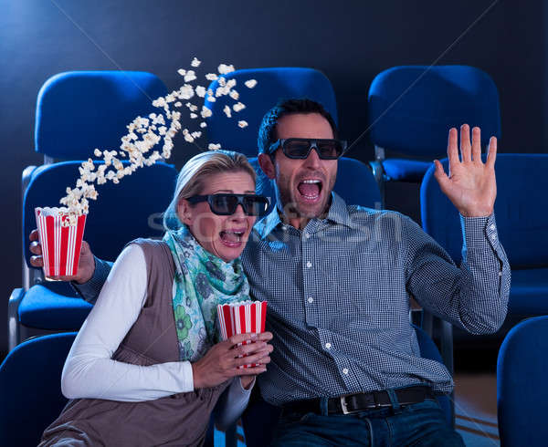 Couple reacting in shock to a 3D movie Stock photo © AndreyPopov