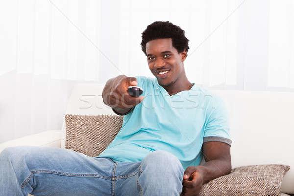 Afrikai fiatalember tv nézés boldog otthon ház Stock fotó © AndreyPopov