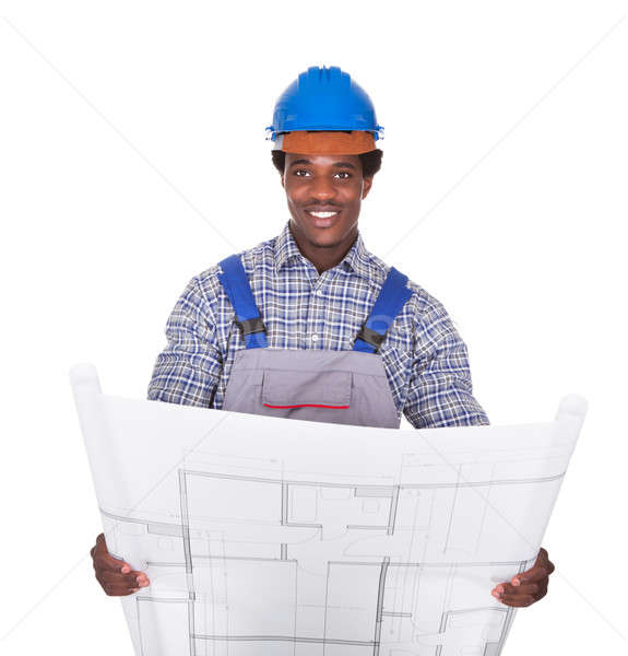 Male Craftsman Holding Blueprint Stock photo © AndreyPopov