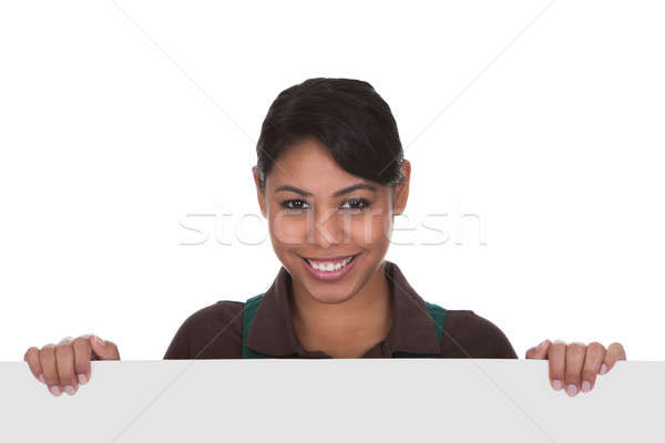 Young Female Gardner Holding Placard Stock photo © AndreyPopov