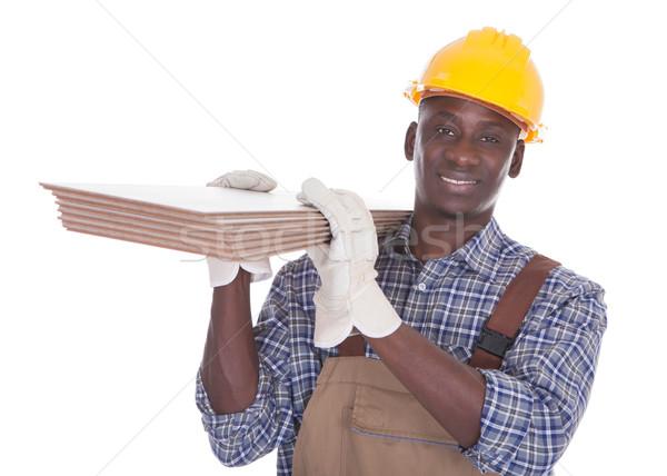 Rzemieślnik piętrze płytek młodych szczęśliwy Zdjęcia stock © AndreyPopov