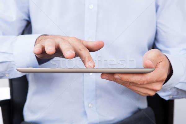 Businessman Using Digital Tablet In Office Stock photo © AndreyPopov
