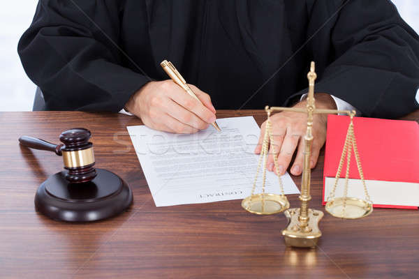 Judge Signing Contract Paper At Desk Stock photo © AndreyPopov
