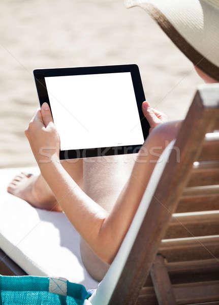 Kadın dijital tablet şezlong ekran rahatlatıcı Stok fotoğraf © AndreyPopov