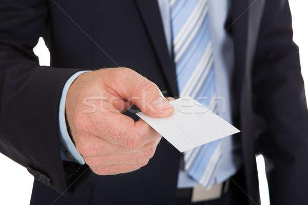 Businessman Holding Blank Visiting Card Stock photo © AndreyPopov