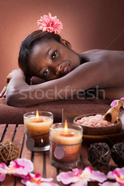 Smiling young woman relaxing at beauty spa Stock photo © AndreyPopov