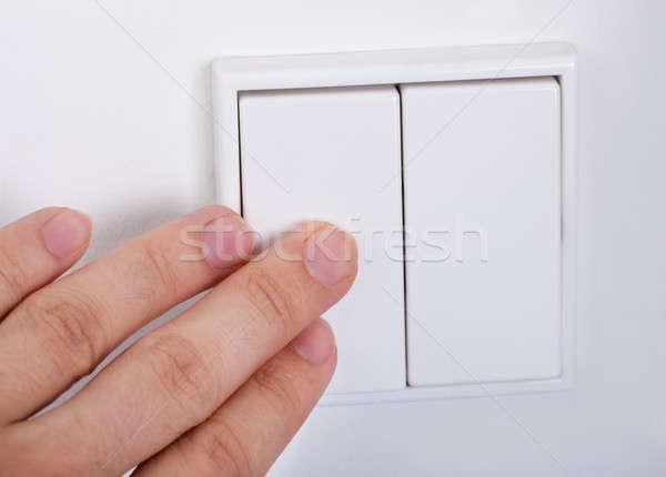 Main interrupteur de lumière mur technologie plaque Photo stock © AndreyPopov