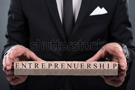 Zakenman tonen ondernemerschap blokken business hout Stockfoto © AndreyPopov