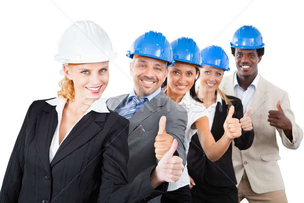 Architects Wearing Hardhats While Gesturing Thumbsup Stock photo © AndreyPopov