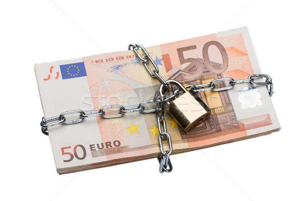Metallic Chain And Padlock Around Euro Bundle Stock photo © AndreyPopov