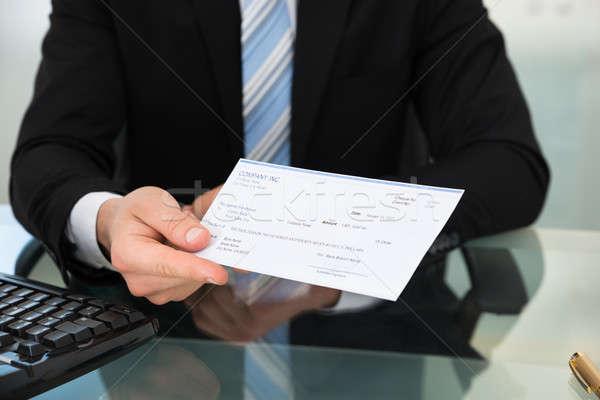 Zakenman tonen cheque bureau kantoor man Stockfoto © AndreyPopov
