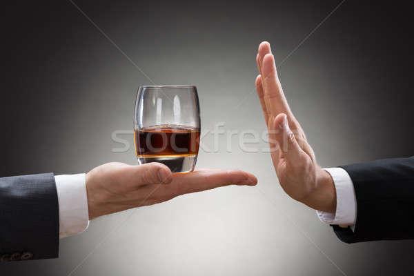 Empresario whisky empresario primer plano mano vidrio Foto stock © AndreyPopov
