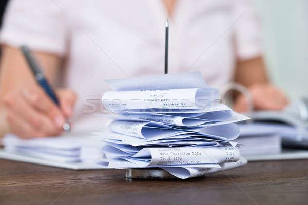 Számlák papír szög üzletember asztal közelkép Stock fotó © AndreyPopov