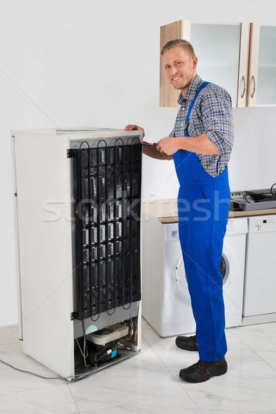 Repairman Repairing Refrigerator Stock photo © AndreyPopov