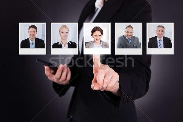 Man Selecting A Profile Picture Stock photo © AndreyPopov